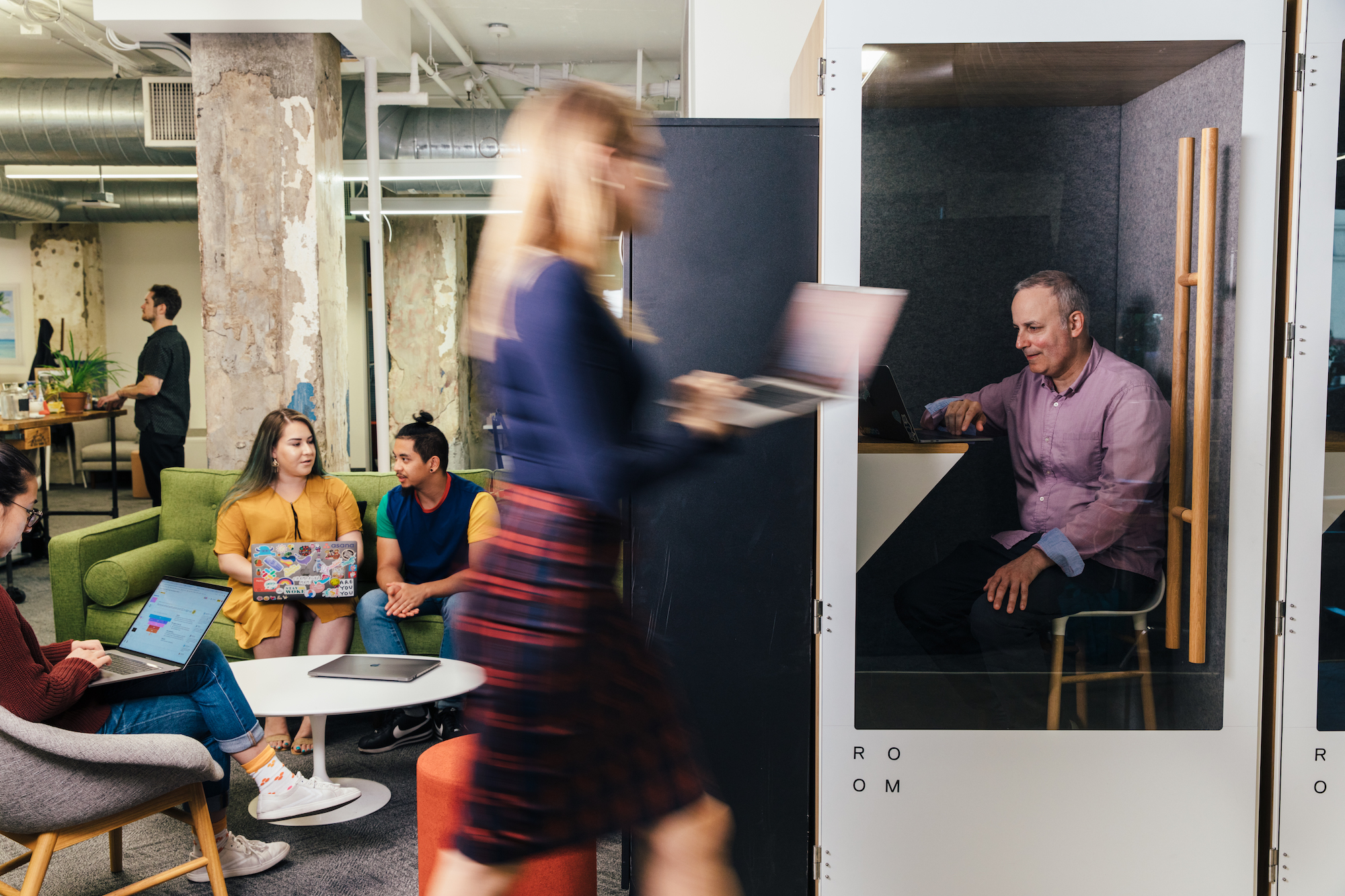 A group of Asana employees in a meeting